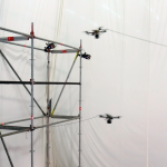 Rise of the Machines: Quadcopter drones build rope bridge